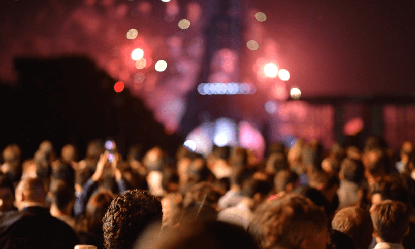 Crowd in front of fireworks at Eiffel Tower
